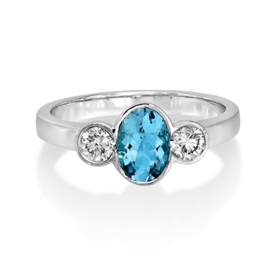 aquamarine ring 0.65ct. set with diamond in three stone ring smallest Image