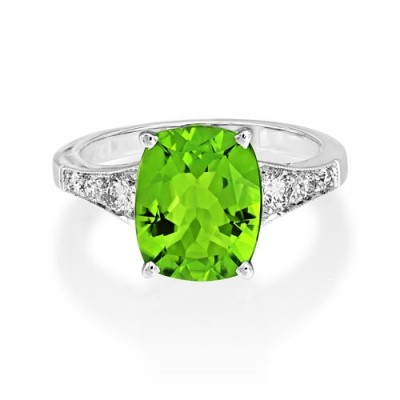 peridot ring 4.48ct. set with diamond in shoulder set ring smallest Image
