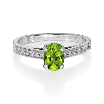 peridot ring 0.93ct. set with diamond in shoulder set ring smallest Image
